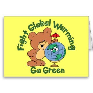 cute teddy standing beside a globe and caption fight global warming go