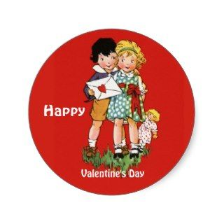 little boy and girl with the boy holding onto a valentine and teh girl