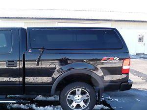 Leer 100XQ Used Black Truck Cap Ford F150 04 08