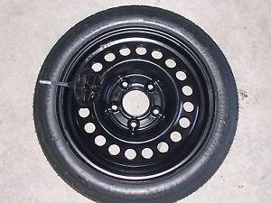 98 Buick LeSabre Compact Donut Spare Tire Rim Wheel w Nut Pontiac Chevrolet GM
