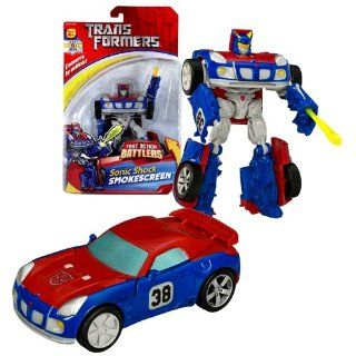 Hasbro Year 2007 Transformers Fast Action Battlers Series 6 Inch Tall Robot Action Figure   Autobot Sonic Shock SMOKESCREEN with Cannon Blast Launcher and 1 Missile (Vehicle Mode: Pontiac Solstice): Toys & Games