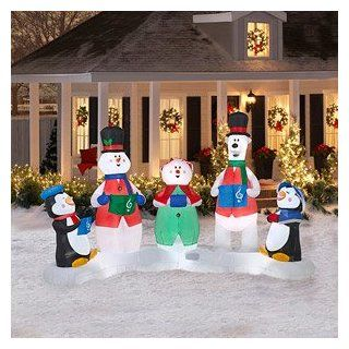 CHRISTMAS DECORATION LAWN YARD INFLATABLE CAROLERS MUSICAL LIGHT SHOW INCLUDES REMOTE CONTROL AND BATTERIES 7' TALL X 10' LONG : Outdoor Decor : Patio, Lawn & Garden